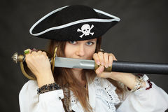 Woman pirate, demonstrates his sword Royalty Free Stock Images