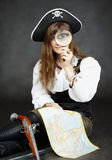 Woman pirate, and map with a magnifying glass Royalty Free Stock Images