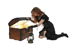 Woman pirate opening chest Stock Photo
