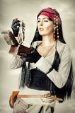 Woman pirate opens the treasure chest Stock Photos