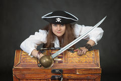 Woman pirate with a sabre and treasures Royalty Free Stock Image