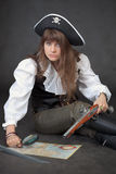 Woman-pirate with sea map and magnifier glass Stock Images