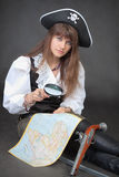 Woman - pirate with sea map and magnifier glass Royalty Free Stock Images
