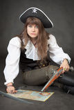 Woman - pirate with sea map and pistol Royalty Free Stock Photo