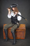 Woman pirate sitting on chest Royalty Free Stock Photo