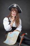 Woman pirates with map and magnifier in hands Stock Image