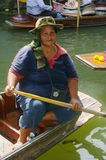 Woman on pirogue Stock Photo