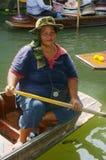 Woman on pirogue stock photo