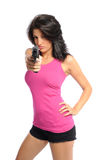 Woman and a pistol. Attractive young hispanic woman with a gun on a white background Stock Image