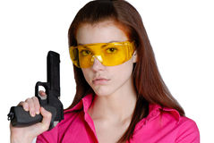 Woman and pistol. Young woman in goggles with  pistol in  hand on  white background Royalty Free Stock Images