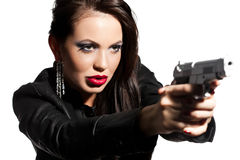 Woman with a pistol in hands. Elegant fashionable woman with a pistol in hands Stock Images