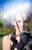 Woman with pitchfork Royalty Free Stock Photography