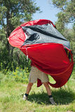 Woman pitching tent Royalty Free Stock Images