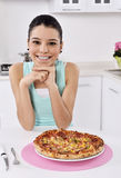 Woman with pizza Royalty Free Stock Images