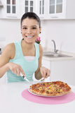 Woman with pizza Stock Image