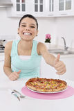 Woman with pizza Royalty Free Stock Photos