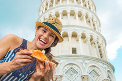 Woman with pizza in front of leaning tower of pisa Royalty Free Stock Images
