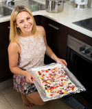 Woman with pizza near oven Stock Image