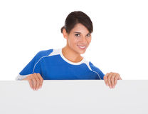 Woman With Placard. Young Happy Woman Holding Placard Over White Background Royalty Free Stock Photo