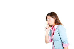 Woman placing finger on lips as if to say, shhhhh, be quiet, silence Stock Image