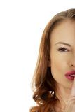 Woman placing finger on lips. Stock Photos