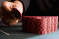 Woman placing gambling chip on table, close-up Royalty Free Stock Photography