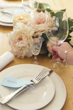 Woman placing a glass into a formal table setting Royalty Free Stock Image