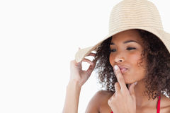 Woman placing her finger on her mouth Royalty Free Stock Photo