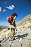 Woman placing her rucksack Stock Photos