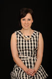 Woman in plaid dress Stock Image