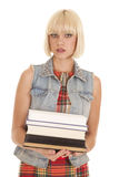Woman plaid dress books stand serious Stock Image