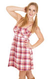 Woman plaid dress pigtails hand hair Royalty Free Stock Photography