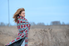 Woman in plaid with flying hair Royalty Free Stock Photography