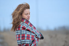 Woman in plaid with flying hair Stock Image