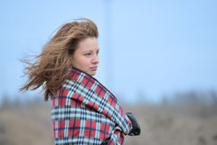 Woman in plaid with flying hair Royalty Free Stock Images