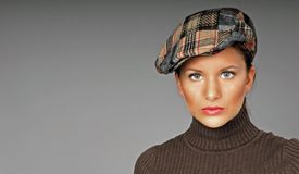 Woman in Plaid Hat Royalty Free Stock Image