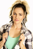 Woman in plaid shirt close hold shirt slight smile stock photography