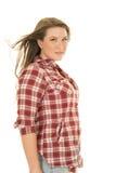 Woman plaid shirt hair blow side serious stock photo