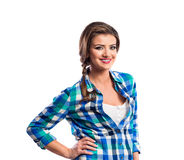 Woman with plait in blue and green checked shirt smiling Royalty Free Stock Photos