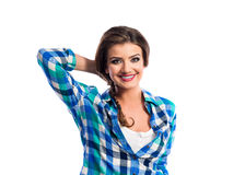 Woman with plait in blue and green checked shirt smiling Stock Photo