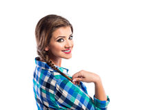 Woman with plait in blue and green checked shirt smiling Royalty Free Stock Photography