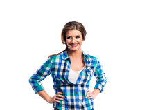 Woman with plait in blue and green checked shirt smiling Stock Photography