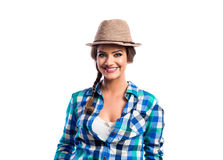 Woman with plait in blue and green checked shirt smiling Stock Photos