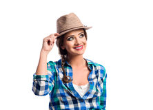 Woman with plait in blue and green checked shirt smiling Royalty Free Stock Image