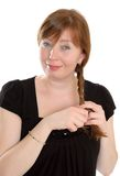 Woman with plait in hand Royalty Free Stock Photography