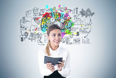 Woman with a planer, brain cogs plan Royalty Free Stock Image