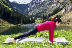 Woman in plank pose outdoors Royalty Free Stock Photography