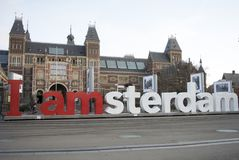 Planking in amsterdam. A woman is planking in front of rijks Museum in amsterdam Royalty Free Stock Image