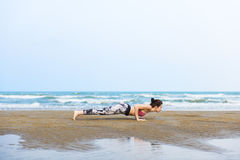 Woman Planking Stretching Flex Training Healthy Lifestyle Beach. Concept Stock Photo