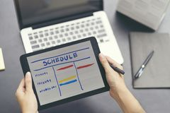 Woman planning agenda and schedule using calendar event planner. Woman hands using plan to vacation on laptop computer. Calender planner organization royalty free stock images